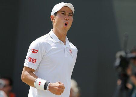 FILE PHOTO - Tennis - Wimbledon - London, Britain - July 7, 2017 Japan's Kei Nishikori celebrates during his third round match against Spain's Roberto Bautista Agut . REUTERS/Andrew Couldridge