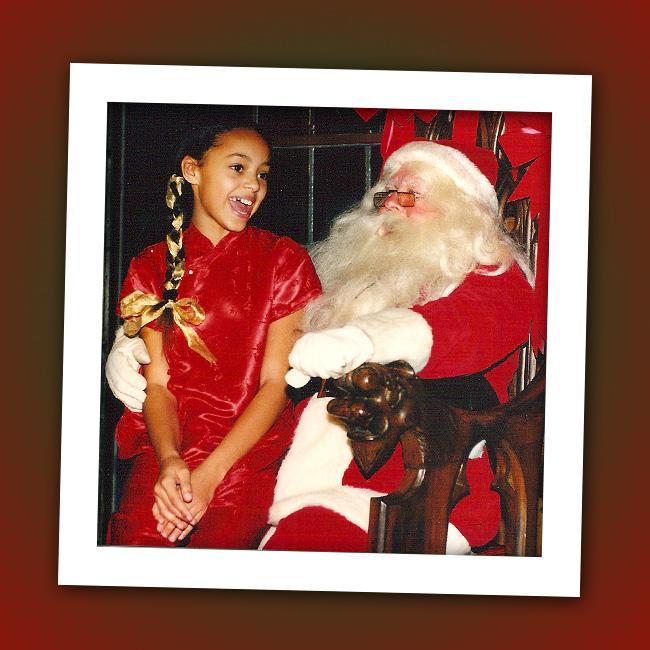 Maybe this girl is telling Santa which college she wants to go to. Can you identify this future coed?