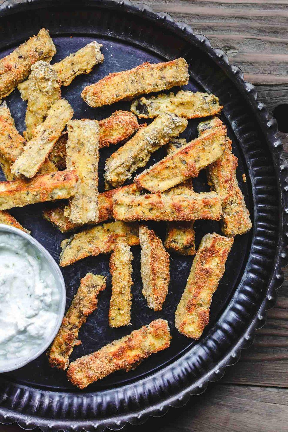 "<p>If you're a fry lover, you know the struggle — you want to eat them <em>all </em>the time. Thankfully, these baked bites are a healthy alternative to enjoy guilt-free.</p><p><a href=""https://www.themediterraneandish.com/baked-eggplant-fries-tzatziki-sauce/"" rel=""nofollow noopener"" target=""_blank"" data-ylk=""slk:Get the recipe from The Mediterranean Dish »"" class=""link rapid-noclick-resp""><em>Get the recipe from The Mediterranean Dish »</em></a><span class=""redactor-invisible-space""><br></span></p>"