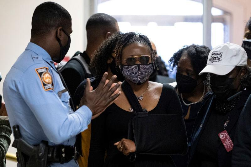 Georgia State Rep. Park Cannon, D-Atlanta, walks past a Georgia State Patrol officer as she returns to the State Capitol in Atlanta on March 29, 2021 after being arrested last week for knocking on the governor's office door as he signed voting legislation.