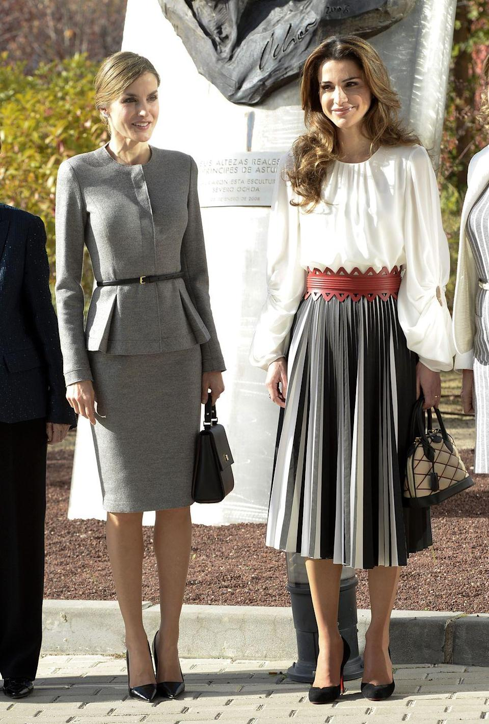<p>A devout Muslim, Rania dresses accordingly, with long sleeves and knee-length or longer skirts, like this one from Proenza Schouler. On a trip to Spain, she and Queen Letizia went head-to-head in a royal fashion face-off.</p>