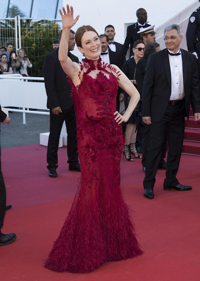 <p>The redhead broke with style conventions and matched her hair to her custom Givenchy gown. (Photo: AP) </p>