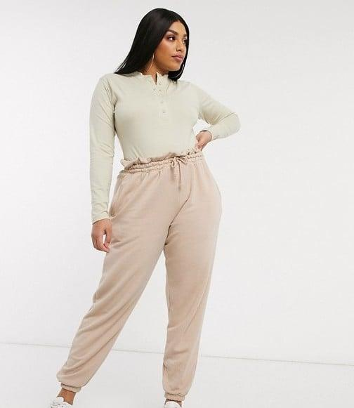 "<p>We'd wear this <a href=""https://www.popsugar.com/buy/Missguided-Plus-Two-piece-560898?p_name=Missguided%20Plus%20Two-piece&retailer=asos.com&pid=560898&price=61&evar1=fab%3Aus&evar9=47346603&evar98=https%3A%2F%2Fwww.popsugar.com%2Ffashion%2Fphoto-gallery%2F47346603%2Fimage%2F47346606%2FMissguided-Plus-Two-piece&list1=shopping%2Ccurve%2Cloungewear%2Ccurve%20fashion&prop13=api&pdata=1"" rel=""nofollow"" data-shoppable-link=""1"" target=""_blank"" class=""ga-track"" data-ga-category=""Related"" data-ga-label=""https://www.asos.com/us/missguided-plus/missguided-plus-two-piece-in-beige/grp/28122?clr=beige&amp;colourWayId=16613604&amp;SearchQuery=&amp;cid=9577"" data-ga-action=""In-Line Links"">Missguided Plus Two-piece</a> ($61) all day.</p>"