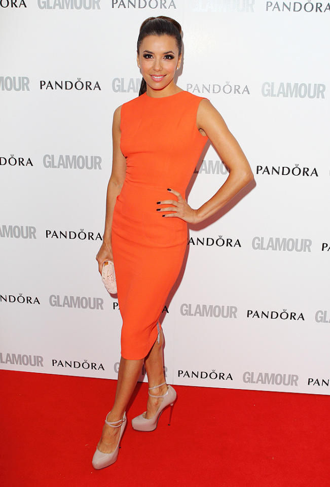"Former ""Desperate Housewives"" actress Eva Longoria, 37, opted for a pop of color in a neon orange, just-past-the-knees number by Victoria Beckham. Longoria, who was honored as one of the magazine's Women of the Year in the category of Inspiration, finished her polished look with a ponytail and nude strappy heels."