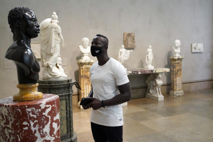 Timothy Musomba wears a mask while viewing sculptures at the newly re-opened Getty Center amid the COVID-19 pandemi,c Wednesday, May 26, 2021, in Los Angeles. (AP Photo/Marcio Jose Sanchez)