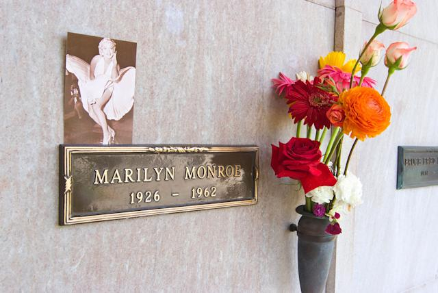 Marylin Monroe's crypt at the Westwood Memorial Park Cemetery. The crypt directly to the left of Marilyn Monroe was purchased by Hugh Hefner in 1992 for $75,000.