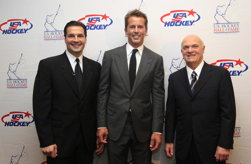 Hockey greats Eddie Olczyk, left, Mike Modano and Lou Lamoriello, right, pose for a photo before the U.S. Hockey Hall of Fame class of 2012 induction dinner in Dallas, Monday, Oct. 15, 2012. (AP Photo/LM Otero)