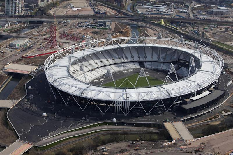 FILE - This is a March 24, 2011 file photo made by the Olympic Delivery Authority, London 2012 (LOCOG), ODA, shows an aerial view of the Olympic Stadium with a newly turfed event field. English Premier League club West Ham has reached a deal to move into London's Olympic Stadium, ending the drawn-out negotiations over the future of the flagship venue. Under the 99-year deal announced Friday, West Ham will make the short move from its 35,000-capacity Upton Park stadium to the revamped Olympic venue in 2016. The 80,000-seat stadium will be downsized to 54,000 seats and be reconfigured with a new roof and retractable seats. (AP Photo/Anthony Charlton, HO, File) EDITORIAL USE ONLY
