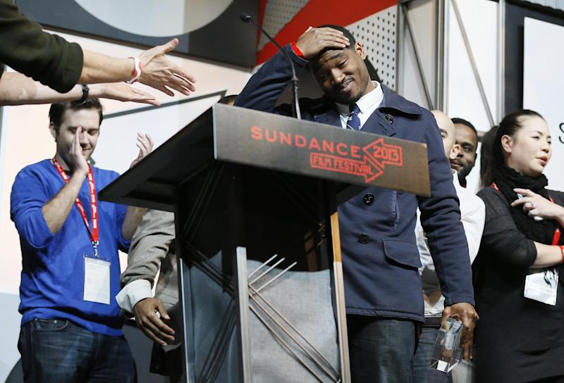 """Director and screenwriter Ryan Coogler reacts as he accepts the U.S. Grand Jury Prize: Dramatic for """"Fruitvale"""" during the 2013 Sundance Film Festival Awards Ceremony on Saturday, Jan. 26, 2013 in Park City, Utah. (Photo by Danny Moloshok/Invision/AP)"""