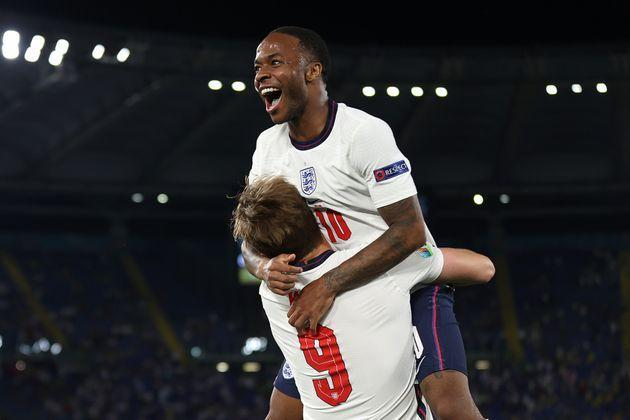 Raheem Sterling and teammate Harry Kane after victory against Ukraine in the quarter-finals. (Photo: Eddie Keogh - The FA via Getty Images)