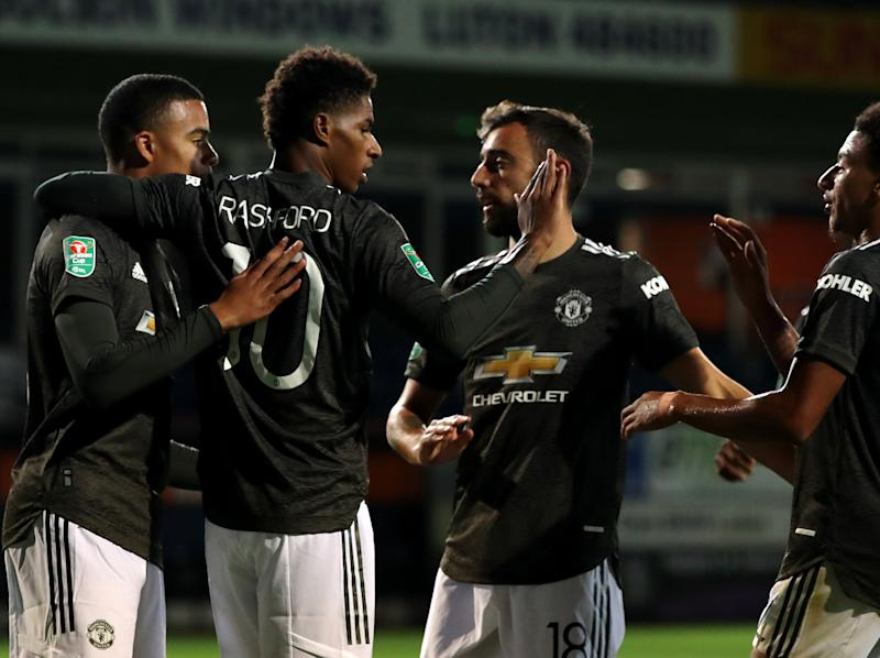 Marcus Rashford celebrates his late goal at Kenilworth Road (Getty Images)