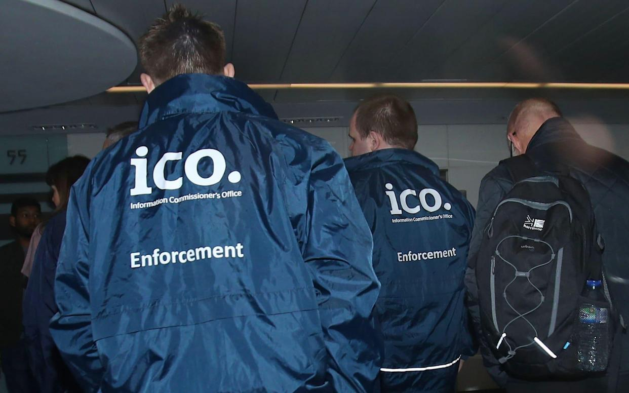Enforcement officers working for the Information Commissioner's Office enter the offices of Cambridge Analytica in central London - PA