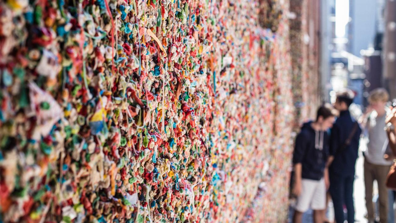 Both Seattle And San Luis Obispohave their own wall of gum. San Luis Obispo's Bubblegum Alleyis 70 feet long and has two walls filled with gumalong Higuera Street. It is believed that the gum tradition came from a rivalry between San Luis Obispo High School and Cal Poly students in the 1950s.Seattle's Gum Wall, which is located under Park Place Market, began in the 1990s with people posting coins on the wall with the help of gum. It has since evolved to just gum.