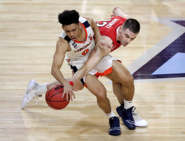 Texas Tech guard Matt Mooney, right, tries to steal the ball from Virginia guard Kihei Clark during the second half in the championship game of the Final Four NCAA college basketball tournament, Monday, April 8, 2019, in Minneapolis. (AP Photo/Matt York)