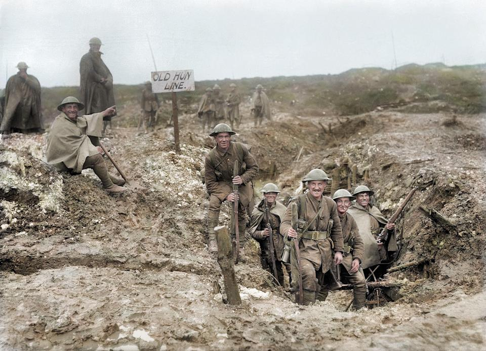 <p>British soldiers smiling and celebrating after capturing a German trench (Royston Leonard / Media Drum World / Caters News) </p>