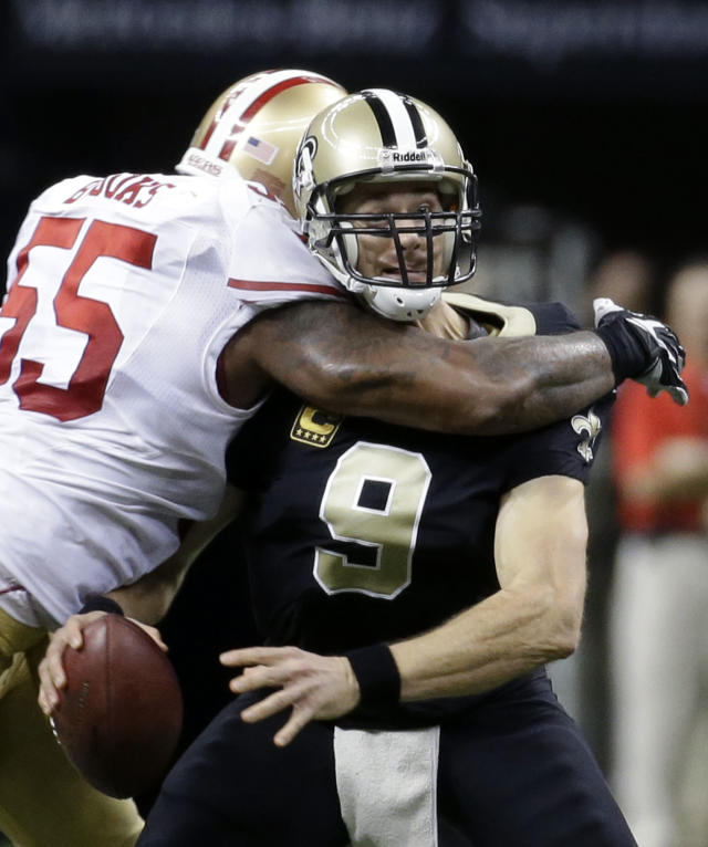 FILE - In this Nov. 17, 2013, file photo, New Orleans Saints quarterback Drew Brees (9) is sacked by San Francisco 49ers outside linebacker Ahmad Brooks (55) in the second half of an NFL football game in New Orleans. Brees fumbled and the 49ers recovered, but Brooks was called for an illegal hit. Almost once a game, an NFL player absorbs an illegal blow to the head or neck that could put his career, or worse, at risk. The NFL has been trying to prevent such blows over the past four years, targeting improper technique and making it a point of emphasis to penalize and fine players for hits that leave themselves and their opponents vulnerable. (AP Photo/Dave Martin, File)