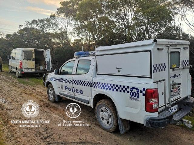 A police car parked behind a van that was used by two men to illegally cross into South Australia from Victoria. Source: South Australia Police