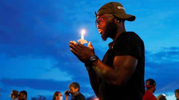 PHOTO: A man holds a candle at the scene of the death, in police custody, of George Floyd, in Minneapolis, June 3, 2020. (Lucas Jackson/Reuters)