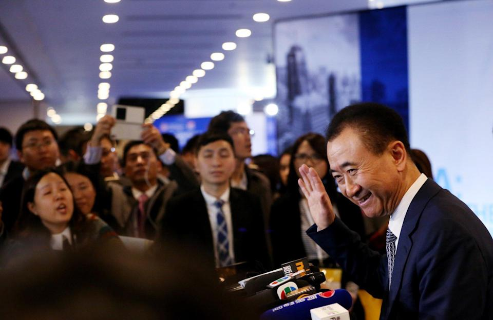 Wang Jianlin of Dalian Wanda speaks to the media after attending the Asian Financial Forum in 2016. The pandemic has hastened the unravelling of his global media empire. Photo: Nora Tam