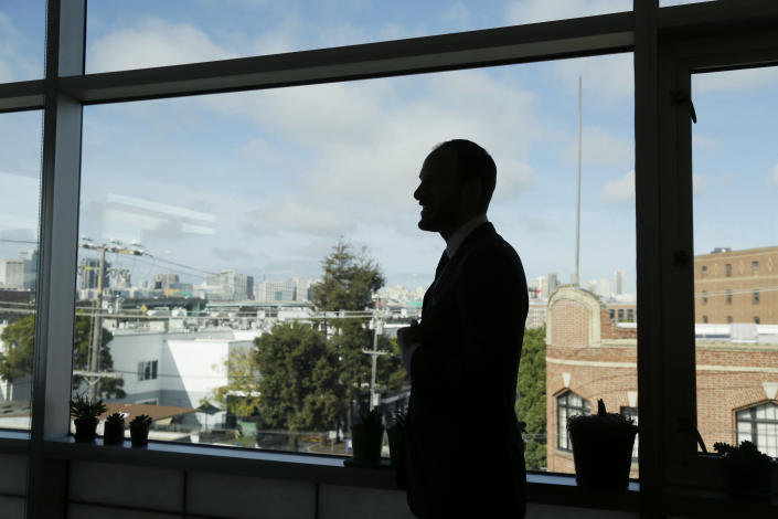 San Francisco District Attorney Chesa Boudin is silhouetted looking out at the skyline from his office in San Francisco on Jan. 30, 2020. Boudin took office as district attorney in San Francisco a year ago as part of a politically progressive wave of prosecutors committed to seeking restorative justice over mass incarceration. But now the former deputy public defender is under fire for the deaths of two pedestrians on New Year's Eve who were run down in an intersection by a 45-year-old parolee. (AP Photo/Eric Risberg)