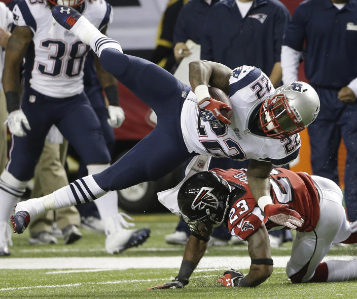 New England Patriots running back Stevan Ridley (22) is hit by Atlanta Falcons cornerback Robert Alford (23) during the first half of an NFL football game, Sunday, Sept. 29, 2013, in Atlanta. (AP Photo/John Bazemore)