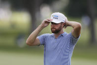 Chris Kirk adjusts his cap on the 14th green during the second round of the Rocket Mortgage Classic golf tournament, Friday, July 3, 2020, at the Detroit Golf Club in Detroit. (AP Photo/Carlos Osorio)