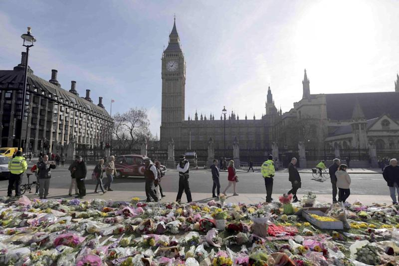 Flowers in Parliament Square (REUTERS)