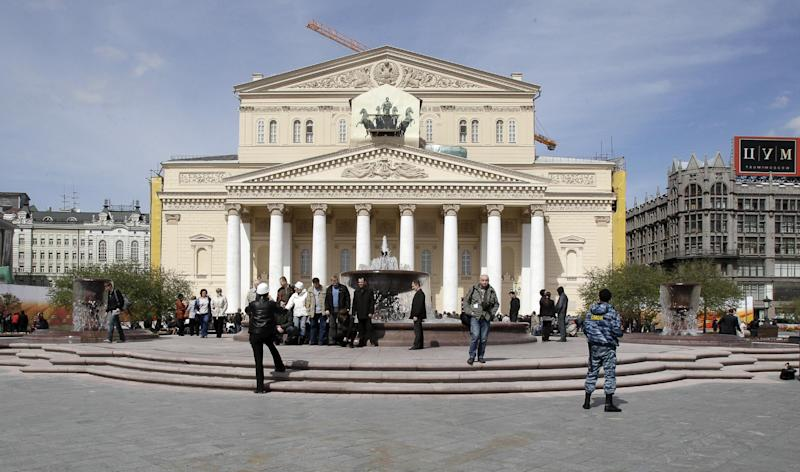 FILE - In this Thursday, April 29, 2010 file photo, people gather at the Bolshoi Theatre for an unveiling ceremony in Moscow. Russia's state audit agency says it is looking into the Bolshoi, a probe that comes amid allegations of mismanagement and corruption at the famed theater. The Audit Chamber said Thursday March 21, 2013, the investigation had been planned in advance and isn't linked to the accusations of financial abuse raised by a dancer who was arrested earlier this month on charges of staging an acid attack on the theater's artistic director Sergei Filin. (AP Photo/Ivan Sekretarev, File)