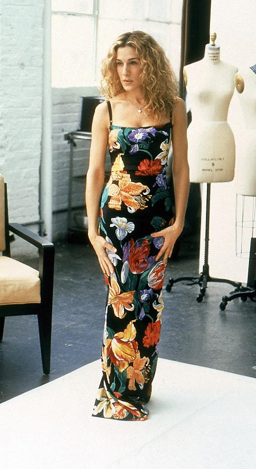 9. Prior to becoming fashion roadkill in bedazzled panties at Bryant Park, Carrie tried on this floral Dolce & Gabbana dress, which ended up being worn on the runway by guest star/supermodel Heidi Klum.