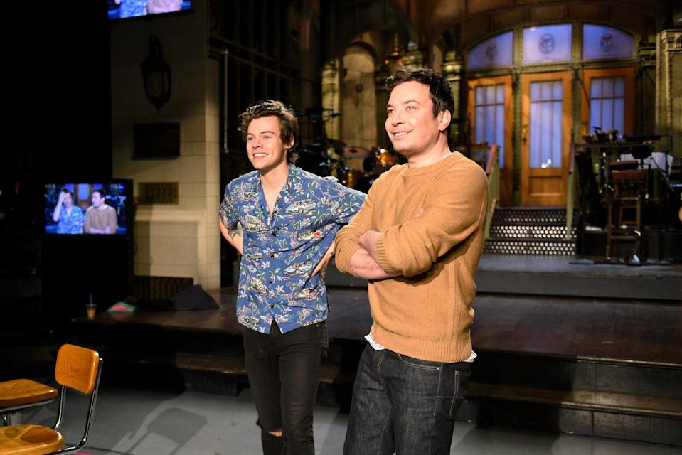Coincidentally, this picture is from the week of Harry's <em>SNL</em> Musical Performance, but he was seen this Saint Laurent button up a lot since December 2016. We won't confirm he single-handedly brought back the Hawaiian palm shirt trend but we won't deny it, either!