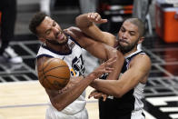Utah Jazz center Rudy Gobert, left, blocks a pass intended for Los Angeles Clippers forward Nicolas Batum during the second half of Game 3 of a second-round NBA basketball playoff series Saturday, June 12, 2021, in Los Angeles. (AP Photo/Mark J. Terrill)
