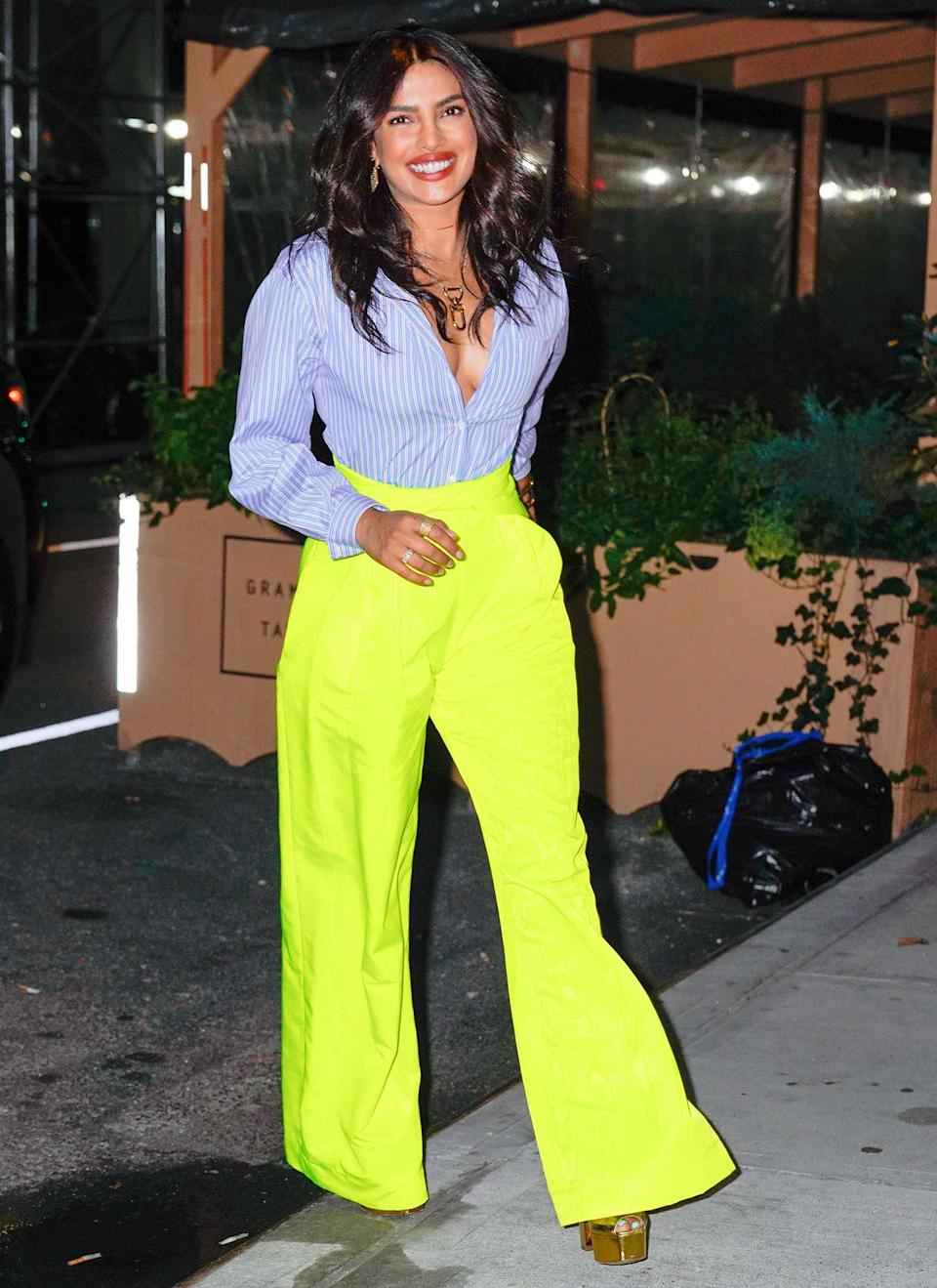 <p>Priyanka Chopra makes a colorful statement at the opening of her new Indian restaurant Sona in New York.</p>