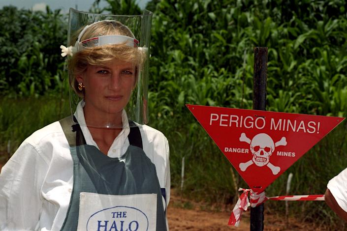 PA NEWS : 15/1/97 : DIANA, PRINCESS OF WALES, WEARS A PROTECTIVE MASK AND JACKET AS SHE STANDS NEXT TO A WARNING SIGN ON THE EDGE OF A MINEFIELD IN ANGOLA, DURING HER VISIT TO SEE THE WORK OF THE BRITISH RED CROSS. (PHOTO BY JOHN STILLWELL ). Clare Short, struck a similar pose when she stood in the midst of a mock-up mine field on Brighton Beach as part of the Government's heightened campaign to ban landmines which was announced during the Labour Party Conference. See PA story LABOUR Landmines.   The International Campaign to Ban Landmines, which came to prominence following the Princess's death, and campaign coordinator Jody Williams were awarded the Nobel Peace prize on 10/10/97. See PA story NOBEL Mines.   Photo by John Stillwell/PA  The Diana, Princess of Wales Memorial Fund, called on the US and British governments to halt the use of cluster bombing in Afghanistan. The fund's chief executive, Andrew Purkis, warned that the weapons, recently deployed against Taliban forces on the front line with the Northern Alliance, represented a serious long-term threat to civilians, similar to that posed by landmines.   (Photo by John Stillwell - PA Images/PA Images via Getty Images)