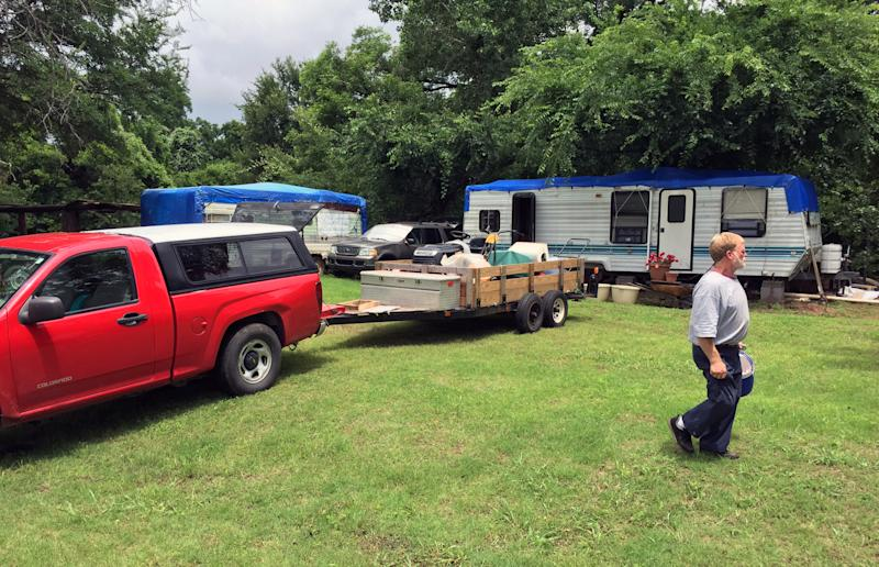 John Welch, 51, spent Wednesday loading up valuables. He plans to evacuate before the Brazos River is predicted to crest on Thursday. (Yahoo News/Jason Sickles)