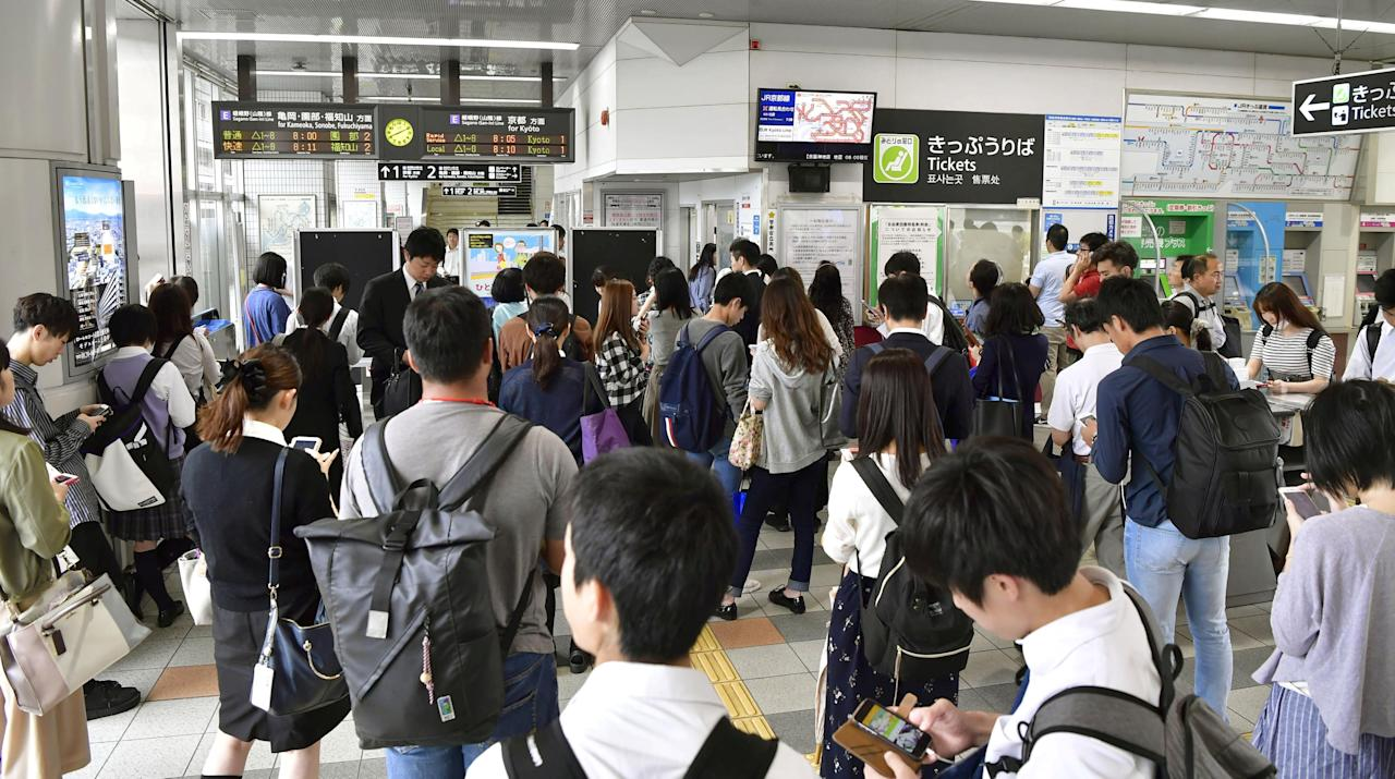 Passengers are seen at Nijyo station in Kyoto, western Japan after train services were suspended because of an earthquake, in this photo taken by Kyodo June 18, 2018.   Mandatory credit Kyodo/via REUTERS ATTENTION EDITORS - THIS IMAGE WAS PROVIDED BY A THIRD PARTY. MANDATORY CREDIT. JAPAN OUT. NO COMMERCIAL OR EDITORIAL SALES IN JAPAN.