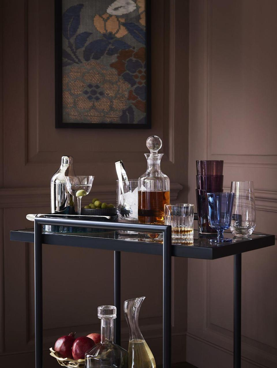 """<p>The bar cart is an essential piece of entertaining, especially after months of not being able to see loved ones. We love this classy black style from John Lewis, which has two open shelves to show off your favourite tipple. </p><p><strong>READ MORE</strong>: <a href=""""https://www.housebeautiful.com/uk/decorate/display/a31904667/drinks-trolley-bar-cart/"""" rel=""""nofollow noopener"""" target=""""_blank"""" data-ylk=""""slk:10 stylish bar carts and 5 ways to style one"""" class=""""link rapid-noclick-resp"""">10 stylish bar carts and 5 ways to style one</a></p>"""