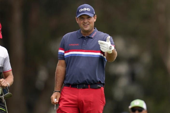 Patrick Reed prepares to play his shot from the 12th tee during a practice round of the U.S. Open Golf Championship, Wednesday, June 16, 2021, at Torrey Pines Golf Course in San Diego. (AP Photo/Gregory Bull)