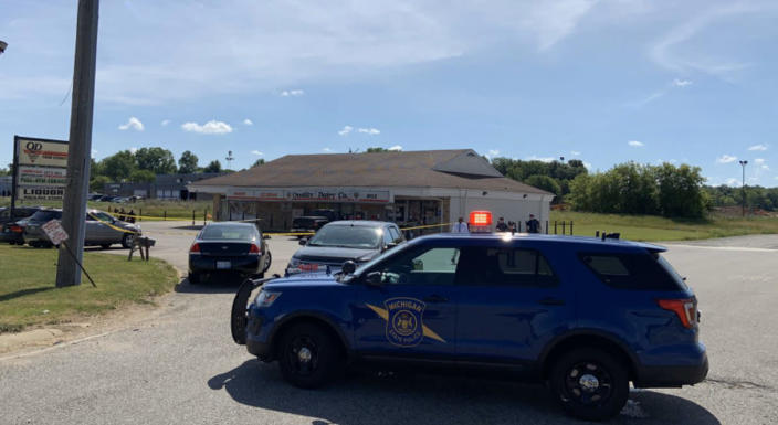 Officers with the Michigan State Police and Eaton County Sheriff's Department respond to a stabbing incident at a Quality Dairy store in Delta Township, Mich., on July 14, 2020. (Michigan State Police Lansing)