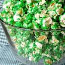"""<div class=""""caption-credit""""> Photo by: Spoonful</div><div class=""""caption-title"""">Green Candied Popcorn</div><p> <i><b>Ingredients:</b></i> 4 quarts popped corn, 1 1/2 cups sugar, 1/2 cup light corn syrup, 2 tablespoons butter, 1/2 teaspoon salt, 1/4 teaspoon cream of tartar, 1/4 teaspoon vanilla, 1 teaspoon baking soda and Green food coloring (I used about 1/8 teaspoon) <br> <br> <i><b>Directions:</b></i> In heavy saucepan on medium heat melt butter then add sugar, corn syrup, cream of tartar and salt. Increase temperature to medium high and bring mixture to a boil, stirring constantly to dissolve sugar. Once mixture boils, add in food coloring and stop stirring. Boil for 5 minutes (Do not stir). Mixture should be about 250-260 degrees. Remove from heat and carefully stir in vanilla and baking soda. Working quickly and while mixture is foamy, pour mixture over popped corn and gently stir to coat popcorn. Place popcorn into a large roaster or rimmed baking sheet (lined with parchment paper or sprayed with cooking spray) and bake at 200° F for 1 hour, stirring every 15 minutes. </p>"""