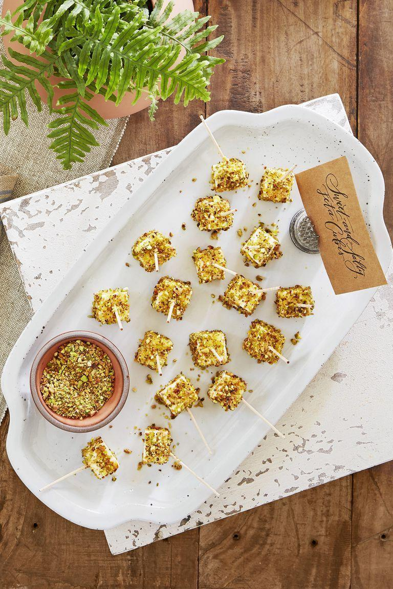 """<p>Chopped pistachios give these irresistible bites a nice crunch.</p><p><strong><a href=""""https://www.countryliving.com/food-drinks/a22739084/sweet-and-salty-feta-cubes-recipe/"""" rel=""""nofollow noopener"""" target=""""_blank"""" data-ylk=""""slk:Get the recipe"""" class=""""link rapid-noclick-resp"""">Get the recipe</a>.</strong></p>"""