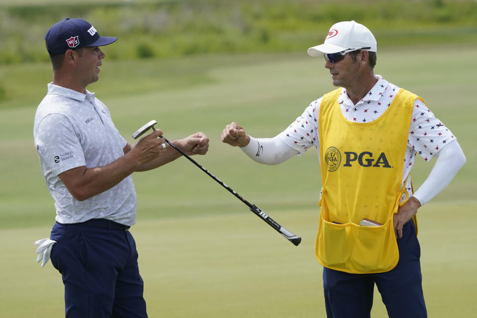 Gary Woodland reacts to his birdie on the fourth green during the third round at the PGA Championship golf tournament on the Ocean Course, Saturday, May 22, 2021, in Kiawah Island, S.C. (AP Photo/Matt York)