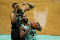 Charlotte Hornets guard Brad Wanamaker (9) drives to the basket past Boston Celtics forward Jabari Parker during the first half of an NBA basketball game on Sunday, April 25, 2021, in Charlotte, N.C. (AP Photo/Chris Carlson)