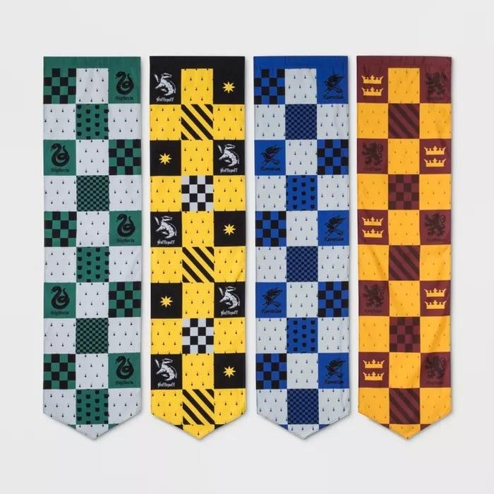 """<p>Whether they're hung together or in separate rooms, the <a href=""""https://www.popsugar.com/buy/Harry-Potter-Four-Piece-Hogwarts-House-Pennants-466100?p_name=Harry%20Potter%20Four-Piece%20Hogwarts%20House%20Pennants&retailer=target.com&pid=466100&price=15&evar1=buzz%3Auk&evar9=44044681&evar98=https%3A%2F%2Fwww.popsugar.com%2Fentertainment%2Fphoto-gallery%2F44044681%2Fimage%2F46975574%2FHarry-Potter-Four-Piece-Hogwarts-House-Pennants&list1=shopping%2Cgifts%2Cgift%20guide%2Charry%20potter%2Cgifts%20under%20%2425%2Cgifts%20under%20%24100%2Cgifts%20under%20%2450%2Cgifts%20under%20%2475%2Cgifts%20under%20%24200&prop13=api&pdata=1"""" rel=""""nofollow"""" data-shoppable-link=""""1"""" target=""""_blank"""" class=""""ga-track"""" data-ga-category=""""Related"""" data-ga-label=""""https://www.target.com/p/harry-potter-4pc-hogwarts-house-pennants/-/A-53266572"""" data-ga-action=""""In-Line Links"""">Harry Potter Four-Piece Hogwarts House Pennants</a> ($15) are majorly cool. </p>"""