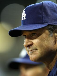 Don Mattingly watches from the dugout during a July 15 game vs. Arizona. A 6-4 victory that night gave the Dodgers a five-game winning streak