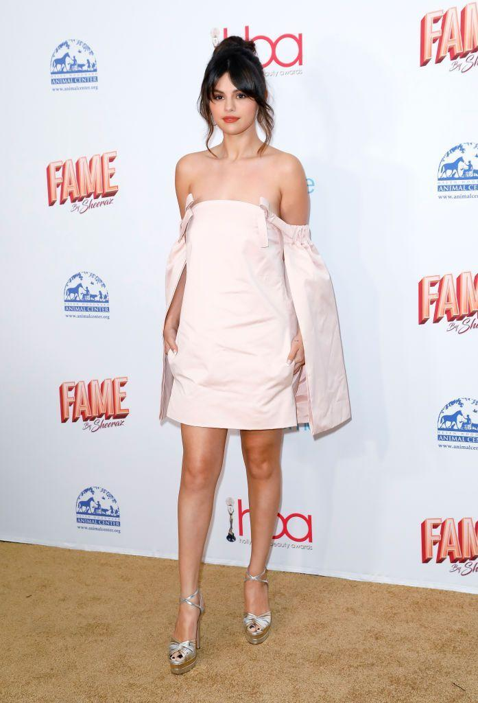 <p>Posing in a blush mini dress by Patou at the 2020 Hollywood Beauty Awards in Los Angeles. </p>