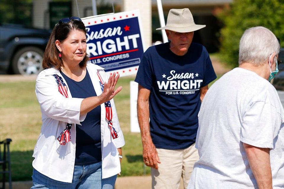 Susan Wright, Republican candidate for Texas' 6th Congressional District, greets voters outside a polling location during early voting for a special runoff election on Thursday, July 22, 2021, in Arlington, Texas.