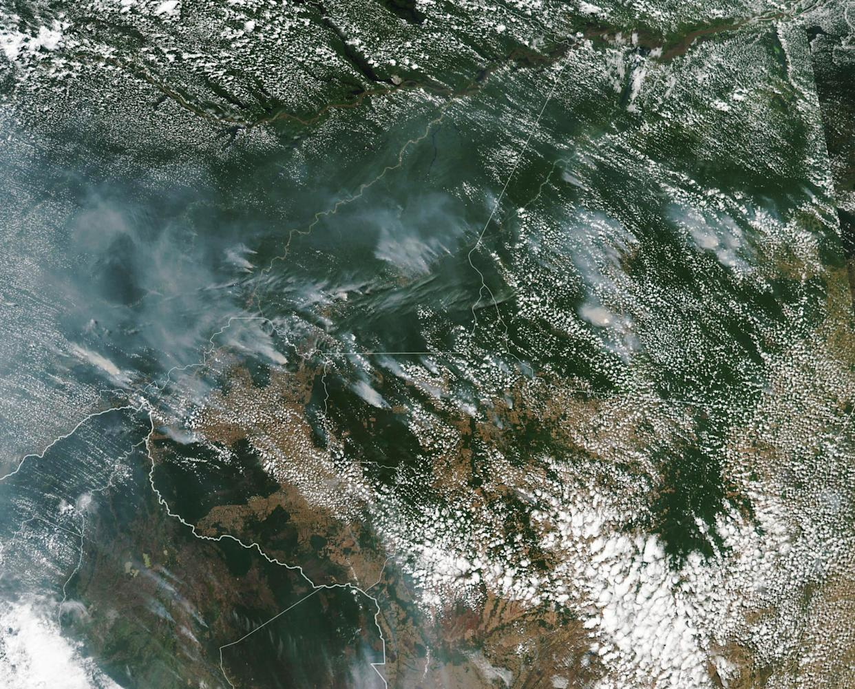 This satellite image provided by NASA on Aug. 13 shows several fires burning in the Brazilian Amazon forest. Brazil's National Institute for Space Research said the country has seen a record number of wildfires this year, counting 74,155 as of Tuesday. (Photo: NASA via ASSOCIATED PRESS)