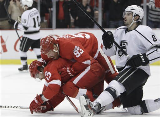 Detroit Red Wings right wing Johan Franzen (93) of Sweden, congratulates teammate Darren Helm (43), next to Los Angeles Kings defenseman Drew Doughty (8) after his go-ahead goal during the third period of an NHL hockey game in Detroit, Friday, March 9, 2012. (AP Photo/Carlos Osorio)