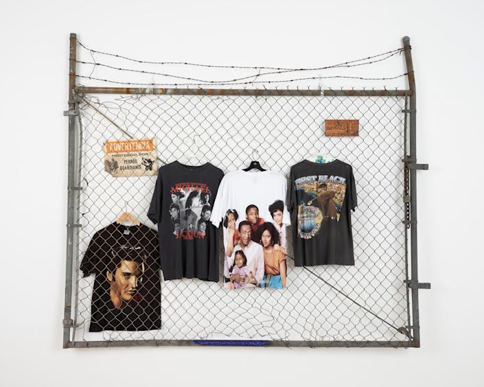 So many clothes I ran out of hangers (Black, White & Grass), 2019 Metal fence with barbed wire, assorted tees on hangars 82 x 98 x 9 inches