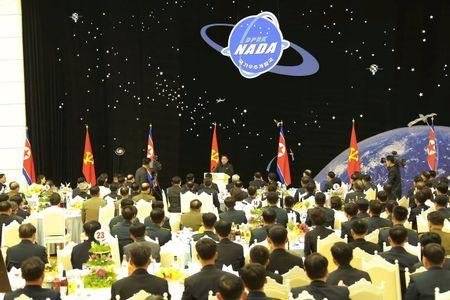 KCNA picture of North Korean leader Kim Jong Un attending a banquet for contributors of the recent rocket launch